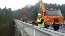 Montáž kabelů na most