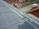 Montáž sněhových zábran na střechu
