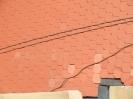 Střecha poškozená pádem omítky - po opravě
